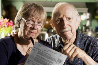 Bigstock-Elder-Couple-With-Bills-3557267 (3)